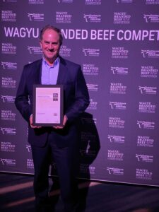 Stockyard Managing Director lachie Hart holding the A W A gold award